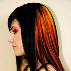 Create a stark contrast with your dark hair with fiery orange, red and yellow highlights.