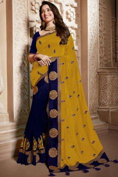 Mustard silk saree with navy blue banglori silk blouse, embellished with dori work, sequins, stone work and zari work. Saree with Round Neck, Half Sleeve. It comes with unstitch blouse, it can be stitched 32 to 58 sizes. #mustard #silk #saree #blouse #Andaazfashion #UK Bollywood Designer Sarees, Bollywood Saree, Chiffon Saree, Silk Sarees, Blouse Online, Sarees Online, Mustard Wedding, Floral Print Sarees, Wedding Saree Collection