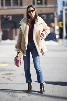An aviator jacket with cropped jeans and booties.