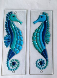 A beautiful Fused Glass Wall Hanging of a Seahorse. This would particularly enhance any bathroom or shower room. The Picture is made by hand using transparent glass and fixed onto the wall with chrome fixings (supplied) The glass hanging measures 11cm x 30cm approx. We will be