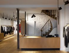 Inspiration: Isabel Marant store in Paris, France. Absolutely love the white brick contrast with the wood details.