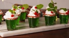 Mistletoe Shots   - Delish.com make with Tequila. Rim with salt for a Holly Jolly margarita Jell-O shot