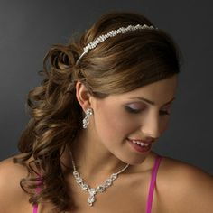 """This headband is silver plated and features a stunning rhinestone braid. Perfect for your classic or modern wedding, the ornamented portion of this piece measures 7-1/4"""" wide and 1/2"""" tall, and the piece ends with two loops that allow you to fasten it in your hair with bobby pins. #timelesstreasure"""