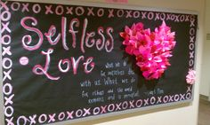 """This bulletin board highlights the importance of love, specifically selfless love. Although simple in content, it is complex in its detail and in its message, and is a radiant source of inspiration that serves as an excellent reminder about what the true intention and source of love should be for our residents during this ""month of love."""""
