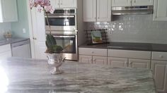 Another great kitchen by USA Stone and Tile! Island and Butler's Pantry is Fantasy Brown and the perimeter is made of Grey Expo Fantasy Brown, Kitchen Cabinets, Kitchen Appliances, Kitchens, Blue Backsplash, Butler Pantry, New Kitchen, Kitchen Ideas, Kitchen Remodel