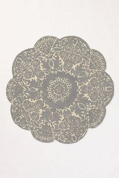 What's prairie decor without Doilies? A doily rug will soften those bare floors...