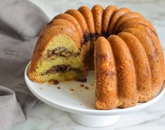 (TESTED & PERFECTED RECIPE) From Zingerman's Bakehouse, a rich and buttery sour cream coffee cake with a cinnamon-nut swirl.