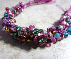 Free Kumihimo Seed Bead Patterns included beaded Kumihimo bracelets, using a bead spinner and Kumihimo braided necklaces, along with videos on adding Pandora style beads to Kumihimo, beaded Kumihimo with long Magatama beads and adding beads to a flat Kumihimo braid.