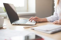 Free Image: Business Woman Working on Laptop in Her Office   Download more on picjumbo.com!