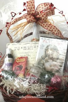 Create a Romantic Date Night gift Basket shrinkwrapped with movie, cider, massage oil, candles and chocolate