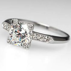round diamond with square setting. love.