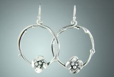 "10st 437 - Sterling Silver 1 1/4"" Twig Earrings with Small Dogwoods on Silver Ear Wires."