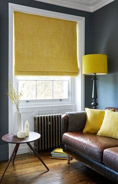 Wooden floors, leather sofa and a pop of yellow with blinds and accessories creates a gorgeous, sophisticated lounge.