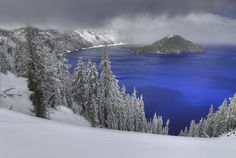 It's a beautiful sighting of Crater Lake National Park on a turbulent winter day! The waters are typically masked by early morning winter fog at Crater Lake, but there are times when the vivid blue waters are clear as day during a crisp winter morning. Crater Lake National Park, National Parks, Crater Lake Oregon, Park Resorts, Central Oregon, Early Morning, Vacation Spots, Travel Usa, Natural Beauty