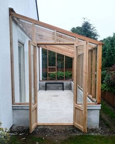Lean to greenhouses and solariums are a wonderful architectural feature that you can grow food in. See some lean to greenhouse plans, inspiration for solariums, lean to greenhouses with water collection and cold frames and building and design tips. Lean To Greenhouse, Backyard Greenhouse, Greenhouse Ideas, Greenhouse Attached To House, Homemade Greenhouse, Greenhouse Wedding, Diy Small Greenhouse, Greenhouse Kitchen, Cheap Greenhouse