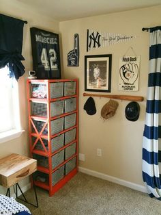 Use a bat to hang things for the vintage baseball nursery