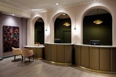After. The finished hotel reception desks, the reception pods are wrapped in bronze leather, bespoke Richard III artwork and gold leaf pendants.