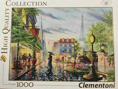 Pareja bajo la lluvia buscando un café en París. 1000 piezas de Clementoni. Encuéntralo en Puzzlemania