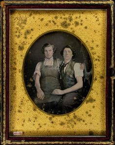 ca. 1850's, daguerreotype portrait of two gentlemen; one in a work shop apron sitting on the lap of another wearing plaid vest