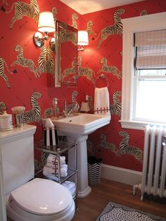 Designer Snapshot: Seeing Red | New England Home Magazine  I actually love deep-colored bathrooms.  But it's not a priority.  I do think it's nice to have one room, like a guest bath, be a little bold.  But we can get around to doing that later.  Just thought I'd pin it for now.
