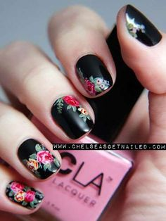 Take a black manicure from gothic to girlie with just a few bright flowers. Chelsea King was inspire... - Chelsea Queen