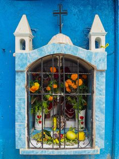 Religious niche filled with marigolds for Day of the Dead 2015