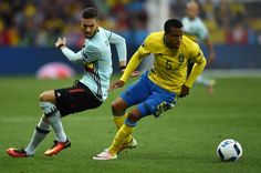 Belgium's forward Yannick Ferreira-Carrasco (L) vies for the ball against Sweden's defender Martin Olsson during the Euro 2016 group E football match between Sweden and Belgium at the Allianz Riviera stadium in Nice on June 22, 2016. / AFP / BULENT KILIC