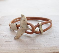 Hey, I found this really awesome Etsy listing at https://www.etsy.com/listing/186890213/whale-tail-bracelet-nautical-bracelet