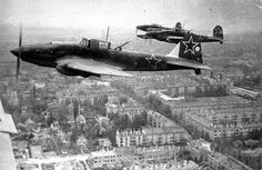 Soviet Ilyushin Il-2 ground attack aircraft fly in the skies above Berlin, Germany in 1945.