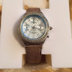 Anne Klein watch Anne Klein watch. Band has signs of wear but is easily replaceable. Battery is dead. Also easily replaceable. Beautiful looking face Anne Klein Jewelry