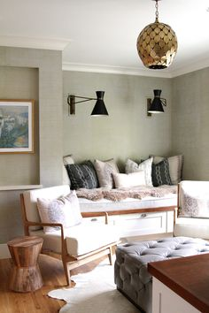 A cozy bench nook, mid-century chairs, tufted ottoman, fabulous light fixtures