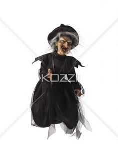 view of a witch on her broomstick. - View of a witch on her broomstick over plain background.