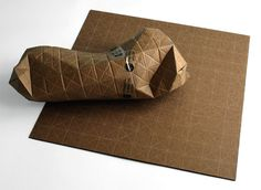 UPACKS: flat sheet of corrugated cardboard that folds and conforms to any shape, while still protecting contents