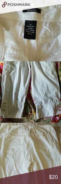 Rafaella capri shorts in white size 10 EUC white Capri pants. The buttons on each ankle adds a nice touch! Has one cargo pocket on left leg. No stains, rips, worn couple of times only. Been in storage since they don't fit, excuse the wrinkles. Rafaella Pants Capris