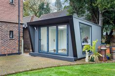 This innovative garden room cladding project was installed with Hyperion Pioneer composite decking in Stone. Take a read of the full case study for more info! Composite Cladding, Composite Decking, Evergreen Vines, Garden Office, Wooden Garden, Place Settings, Garden Styles, French Country, Outdoor Gardens