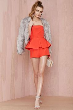 Get a little peplum in your step with this orange romper by Finders Keepers.