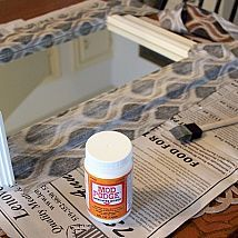 Decoupage a mirror using fabric and Mod Podge as your medium!!!