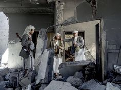 #YearinPictures: Group of fighters loyal to Sheik Ali Aiyedh inside the Sheik's destroyed house. Mathbah district. Sana'a Yemen. September 8 2015.  #LorenzoMeloni/#MagnumPhotos.  Magnum's Photos of 2015 as curated by Peter van Agtmael features the Magnum membership's choice of their favorite images of the year. by magnumphotos