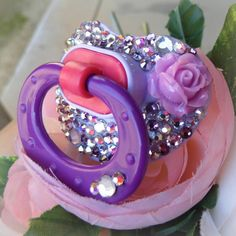 Hey, I found this really awesome Etsy listing at http://www.etsy.com/listing/124842067/bling-rhinestone-pacifier-paci-binky-nuk
