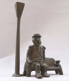 #Bronze #sculpture by #sculptor Remi Dimitrov titled: 'Old captain (Seated Old Man and Lamp sculpture statue)'. #RemiDimitrov