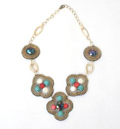 LILY- MULTI -  A combination of round turquoise beads, coral pieces, coin pearls and iridescent crystals make this necklace unique in style and shape. Textured gold toned chain. Pendants are surrounded by gold and silver Japanese seed beads and enforced with black felt backing.
