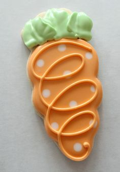 Cute polka dot carrot. This is a great sugar cookie decorating tips.
