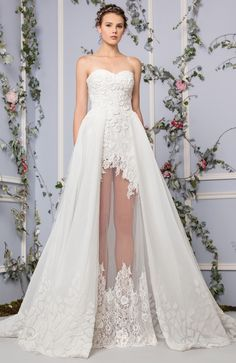 Off White semi sweetheart Lace dress embellished with patchwork embroidery and a Tulle overskirt.