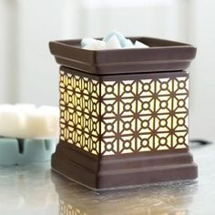 """MODERN GRAPHIC SCENTGLOW® WARMER  Glazed ceramic Warmer with a geometric pattern delivers chic style. Place Scent Plus® Melts, sold separately, in the top dish for a room full of rich scent. Glazed ceramic; black cord. 5""""h, 4½"""" square."""