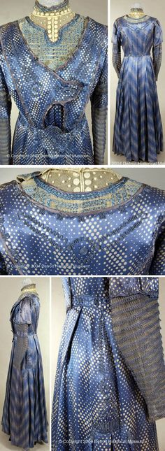 Day dress, B.A. Krenz, Detroit, ca. 1910-13. Blue with white polka dot satin. Narrow blue braid around neck, sleeves, back & and sides, which is hand-sewn. Front closure and white lace inlay at neckline. Long, narrow sleeves have band of crocheted fabric in their middle with button at wrist. Skirt pleated front & back. Detroit Historical Museum