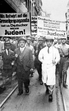 Cologne, Germany, 1933, SA Men Forcing Jews to March Wearing Antisemitic Signboards