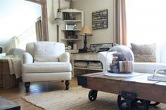 The old mirror trick is used to make this living room look bigger, while working with vintage-style furniture to create a cottage feel. Houzz.com