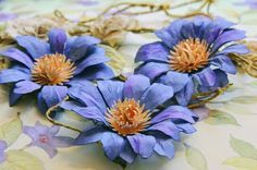 Purple Passion Flower Tutorial by Lisa Gregory ~ uses the Tim Holtz Tattered Floral Die & McGill Punch for flower centers.