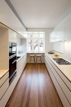 | When doing a small kitchen design for an apartment, either a corridor kitchen design or a line layout design will be best to optimize the workflow. Th... Ikea Galley Kitchen, Small Galley Kitchens, Galley Kitchen Design, Galley Kitchen Remodel, Kitchen Room Design, Interior Design Kitchen, Kitchen Designs, Kitchen Ideas, Kitchen Small