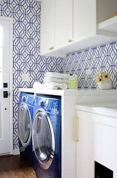 For wall space that's too tight for artwork, graphic patterned wallpaper provides the right amount of modern detail. And bonus points for matching your wallpaper and appliances - love that blue!